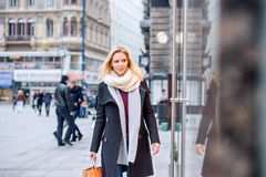 Woman window shopping in centre of the city. Winter Royalty Free Stock Images