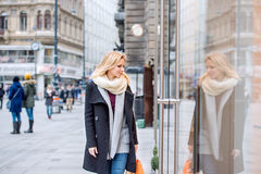 Woman window shopping in centre of the city. Winter Stock Image