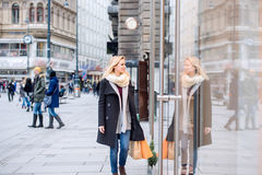 Woman window shopping in centre of the city. Winter Stock Photography