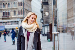 Woman window shopping in centre of the city. Winter Royalty Free Stock Photography