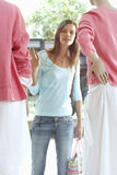 Woman window shopping, looking at mannequins in clothes shop Royalty Free Stock Image