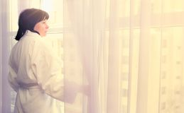 Woman by the window sunlight Royalty Free Stock Photo