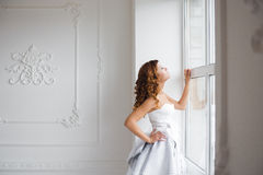 Woman by the window. Royalty Free Stock Photos
