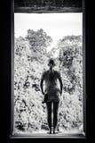 Woman in window Stock Photos