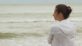 Woman at Windy Beach stock footage