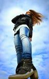 Woman on windy beach Stock Image