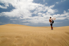 Woman in windy Maspalomas Duna Stock Photos