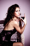 Woman and wine Stock Image