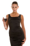 Woman in cocktail dress holding glass of red wine Stock Image
