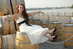 Woman on wine barrel Royalty Free Stock Images