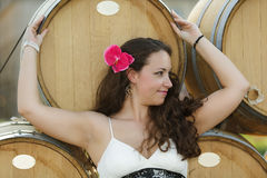 Woman and wine barrels Royalty Free Stock Photography