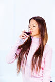 Woman and wine. Brunette woman drinking glass of wine Royalty Free Stock Images