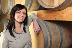 Woman in a wine cellar Royalty Free Stock Image