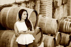 Woman in wine cellar Stock Image