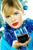 Woman with wine at Christmas Royalty Free Stock Photography