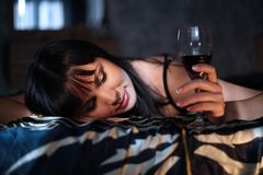 The woman with a wine glass Stock Images