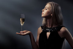 Woman with wine glass in hand Stock Images