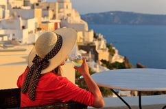 Woman with wine glass in Santorini, Greece Royalty Free Stock Photos