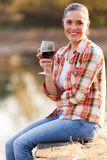 Woman wine lake Royalty Free Stock Photography