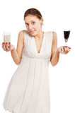 Woman with a wine and milk in her Royalty Free Stock Photo