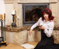 Woman with wine near fireplace Royalty Free Stock Photo
