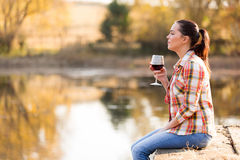 Woman wine pier Royalty Free Stock Image