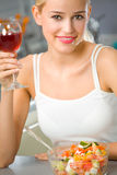 Woman with wine and salad Royalty Free Stock Photography