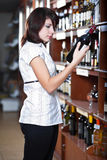 Woman in wine shop Stock Photo