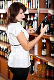 Woman in wine shop Stock Photos