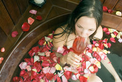 Woman with Wine in Tub - Horizontal Royalty Free Stock Photography