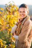 Woman winegrower standing in vineyard outdoors in autumn Royalty Free Stock Photography