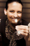 Woman At Winery. Smiling Person Sipping And Tasting Red Cabernet Merlot Wine Inside A Winery In A Taste Testing Conceptual Stock Photography