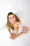 Woman with wings (seated) 1. An attractive young woman wearing wings sitting cross-legged Royalty Free Stock Photography