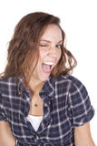 Woman wink blue shirt Stock Photo