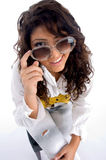 Woman winking behind the eyeglasses Stock Image