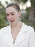 Woman winking at the camera Royalty Free Stock Photos
