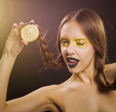 Woman winking eye stock photography