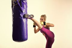 Woman winner athlete, kick boxing. Sport coach in gym with punching bag. Knockout, energy, sport success. Boxer girl workout, healthy fitness. Woman boxing in Royalty Free Stock Photo