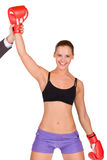 Woman winner in boxing gloves. Young beautiful woman winner in boxing gloves Stock Photography