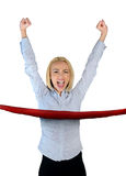 Woman winner. Business woman crossing finish line Royalty Free Stock Images