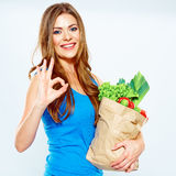 Woman winner with green food . diet concept. White background Royalty Free Stock Photo