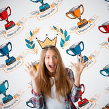 Woman with winner`s cups. Happy young woman with drawn crown and winner`s cup on light background. Leadership concept Stock Photo