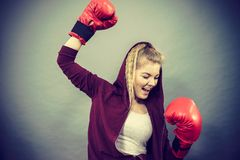 Woman winner wearing boxing gloves royalty free stock photos