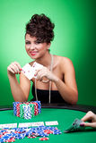 Woman winning a big poker hand Royalty Free Stock Image