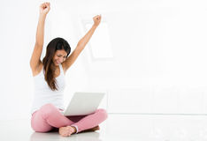 Woman winning online Stock Photo