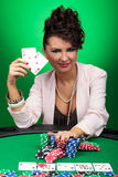 Woman winning at poker Royalty Free Stock Images