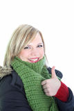 Woman in winter attire giving thumbs up Stock Image
