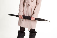 Woman in winter boots and a beige coat. Stock Photo