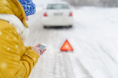 A woman in winter calls to the emergency services. Royalty Free Stock Photo