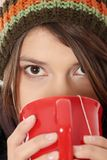 Woman with winter cap drinking something hot Stock Photography